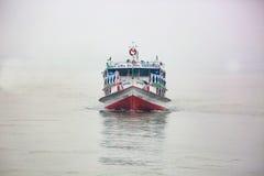 Passenger ferry boat going through fog Stock Image