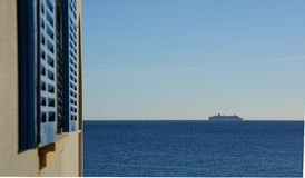Passenger ferry boat. On horizon and window shutters in the forefront. Mallorca, Balearic islands, Spain Stock Photo
