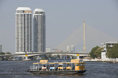 Passenger ferry crossing Chao Phraya River in Bangkok Stock Image
