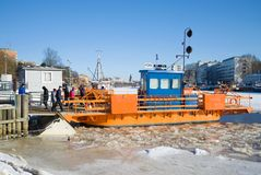 Passenger Ferry `Fiori` at the pier on the Aura river on a February day. Turku, Finland Royalty Free Stock Image