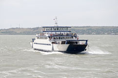 Passenger ferry floating on the waves Royalty Free Stock Image