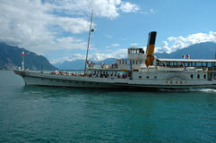 Passenger ferry on Geneve lake in Switzerland. Montreux, Switzerland - August 16, 2014: Old Passenger ferry on Geneve lake nearby Montreux in Switzerland Stock Images