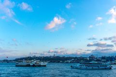 Passenger ferry goes on Golden Horn, a major urban waterway and the primary inlet of Bosphorus in Istanbul royalty free stock photo