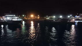 Passenger ferry, in the night port stock video