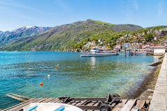 Passenger Ferry at the pier on the shore of lake Maggiore in Ascona Royalty Free Stock Photos