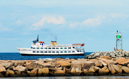 Passenger ferry pulling in to Block Island, Rhode Island. Passenger ferry pulling in to New Harbor, Block Island, Rhode Island stock photo