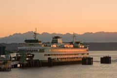 Passenger Ferry at Sunset. Ferry docking during sunset in the Puget Sound, Pacific Northwest, Washington State Royalty Free Stock Photo
