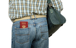 Passenger holding Russian passport in rear pocket. Passenger in blue jeans holding Russian passport in left rear pocket Royalty Free Stock Photos