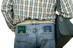 Passenger holding Tonga and Israeli passports in rear pockets. Passenger in blue jeans holding Tonga and Israeli passports in his rear pockets Stock Images