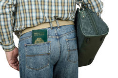 Passenger holding Tonga passport in rear pocket. Passenger in blue jeans holding Tonga passport in left rear pocket Royalty Free Stock Photo
