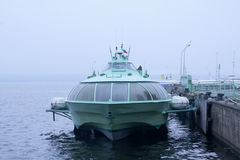 Passenger hydrofoil boat on the docks of Onego lake in foggy weather. Royalty Free Stock Photo