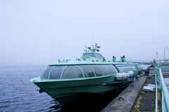 Passenger hydrofoil boat on the docks of Onego lake in foggy weather. Royalty Free Stock Image
