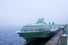 Passenger hydrofoil boat on the docks of Onego lake in foggy weather. Stock Photography