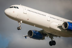 Passenger jet. Closeup of an unmarked passenger aircraft about to land Stock Image