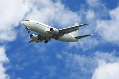 Passenger Jet Aeroplane. Jet aeroplane for passengers in a blue cloudy sky stock photos