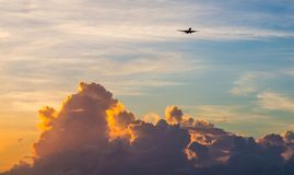 Passenger Jet Aeroplane high above the clouds Stock Photo