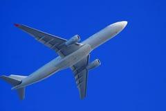 Passenger jet air plane flying Stock Images