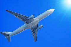 Passenger jet air plane flying Royalty Free Stock Photos