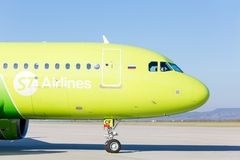 Passenger jet aircraft Airbus A320 of S7 Airlines on runway and ready to take off. Journey and holidays concept. stock photo