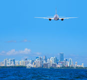 Passenger jet airliner plane arriving flying into Miami International Airport Royalty Free Stock Images