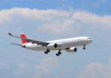 Passenger jet airplane landing Stock Image