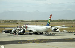 Passenger jet at an airport. Passengers boarding a South African A340 jet on the apron Cape Town Airport Stock Images