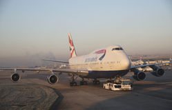 Passenger jet being towed London Airport UK Royalty Free Stock Photos