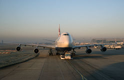Passenger jet being towed London Airport UK Stock Photos