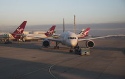 Passenger jet being towed London Airport UK Royalty Free Stock Image