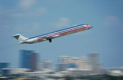 Passenger jet in flight Stock Photos