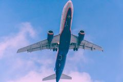 Passenger jet flying over the head which is in landing approach royalty free stock photos