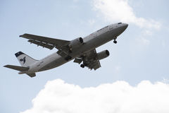 Passenger jet of Iran Air flying overhead Royalty Free Stock Images