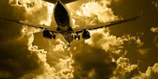Passenger jet landing against amber sky. Passenger jet landing against amber sunset sky 2 Royalty Free Stock Images