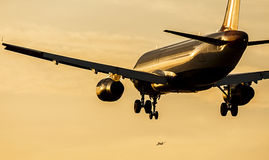 Passenger Aicraft Landing Approach at Sunset Stock Image