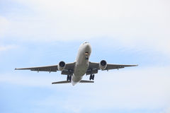 Passenger jet plane flying against beautiful blue sky with copy Royalty Free Stock Photos