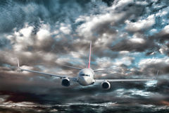 Passenger Jet Plane Flying Low over Rough Water. Passenger airline jet plane in imminent crash danger viewed from an aircraft above flying close to the violent stock images