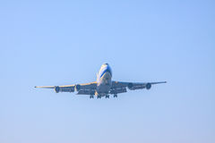 Passenger jet plane preparing to landing on airport runways agai Stock Photos