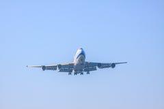 Passenger jet plane preparing to landing on airport runways agai Stock Photos