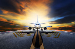Passenger jet plane preparing to take off from airport runways a Stock Photos