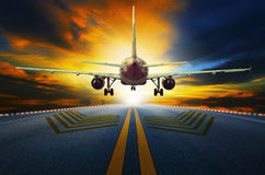Passenger jet plane preparing to take off from airport runways w Stock Image