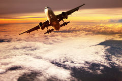 Passenger jet plane take off to mid air against beautiful golden royalty free stock images