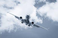Cross-wind landing. Passenger jet on a steep angled landing descent in a cross-wind stock photo