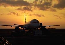Passenger jet on the tarmac. At sunset in hawaii stock photo