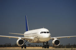 Passenger jet on taxiway Stock Image