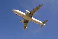 Passenger jetliner taking off. Modern passenger jetliner airplane taking off against blue sky Stock Image