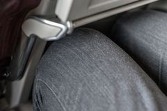 Passenger leg bump into back seat in low-cost commercial airlines. Narrow space for person knee in budget carrier airplane. Cheap. Tickets and travel stock photo