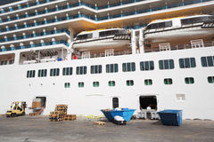 Passenger liner loading at dock day Stock Photos