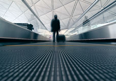 Passenger (Man) rushing through an escalator Stock Images