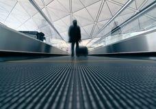 Passenger (Man) rushing through an escalator Stock Images