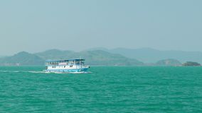 Passenger motor vessel carries tourists to the islands. PHANG-NGA, THAILAND - CIRCA FEB 2014: Passenger motor vessel carries tourists to the islands stock video